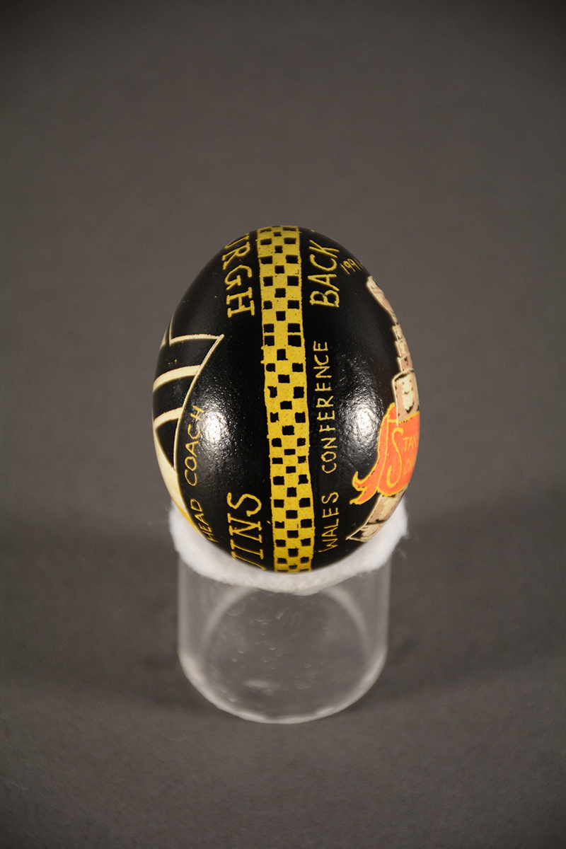 "This egg, done for Head Coach Scott Bowman shows the band that encircles each egg and represents ""the continuous thread of life."" Gift of Pittsburgh Penguins"
