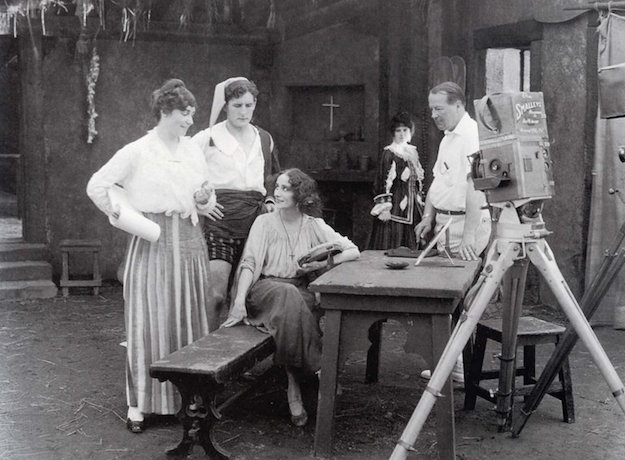 "Weber (standing left) and her husband Phillips Smalley (standing right) confer with legendary ballerina Anna Pavlova during the filming of ""The Dumb Girl of Portici,"" her only screen performance (1916)."