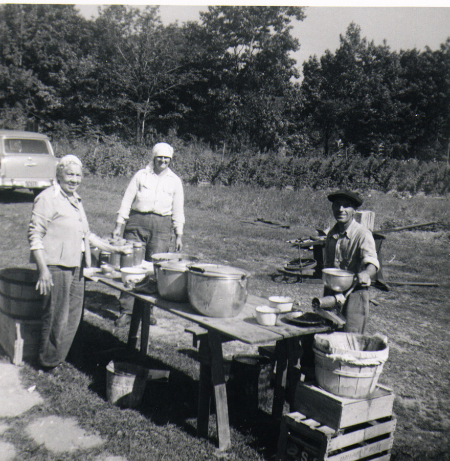 Mrs. Gallo, Lena Scalise, and Angelo Borelli process food to store for the winter, 1958. Courtesy of Elissa Scalise Powell.