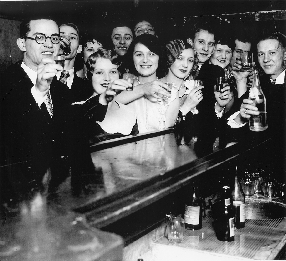 Speakeasy patrons toast the end of Prohibition in 1933.