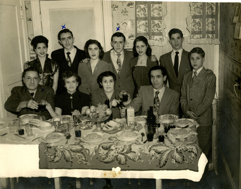 The D'Andrea family toasts before dinner, 1947. Joseph D'Andrea Photographs, MSS 1113, Detre Library & Archives at the History Center.