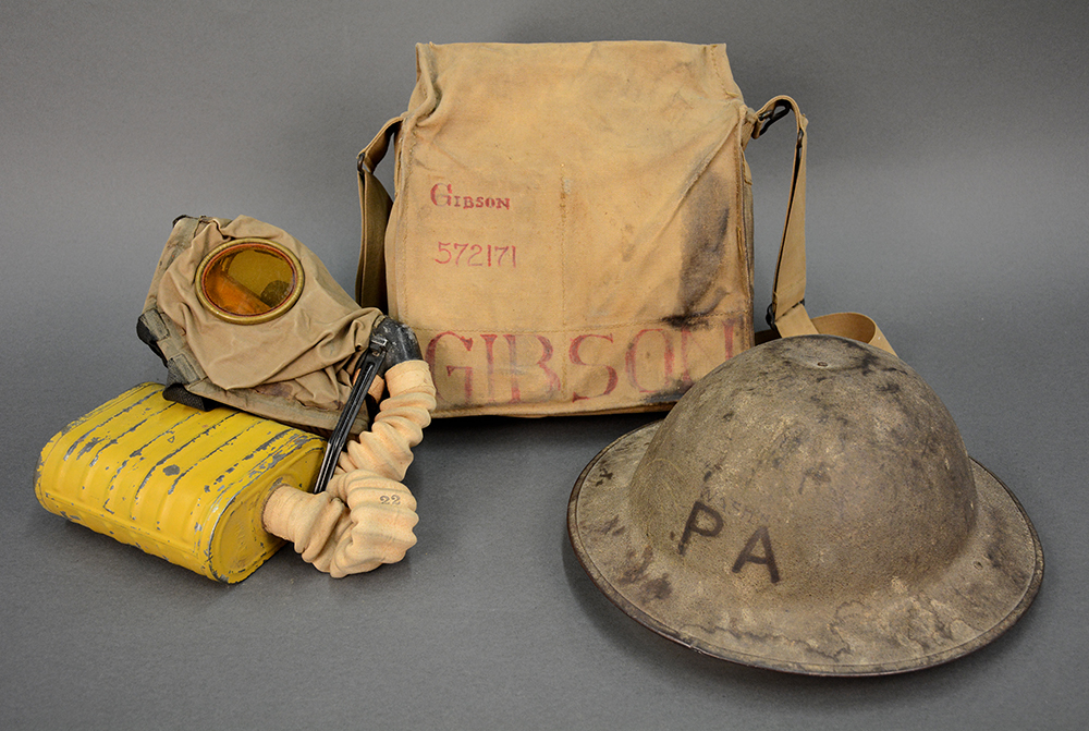 "Gibson's gas mask, bag, and helmet. On the helmet he inscribed ""WASHN"" showing pride in his home of Washington County. Andrew Masich collection, photo by Liz Simpson."