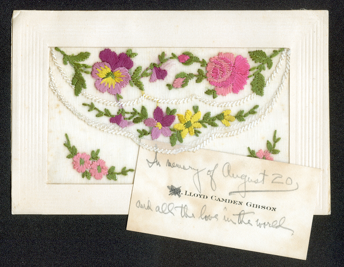 Postcard from France with delicate embroidery on the front envelope.