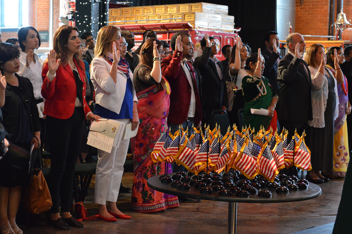 New American citizens are sworn in at a naturalization ceremony at the Senator John Heinz History Center, May 2016.