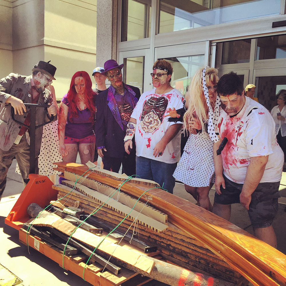 A group of Romero fans dressed as zombies to help dismantle and move the bridge from the Monroeville Mall. Photo by Emily Ruby.