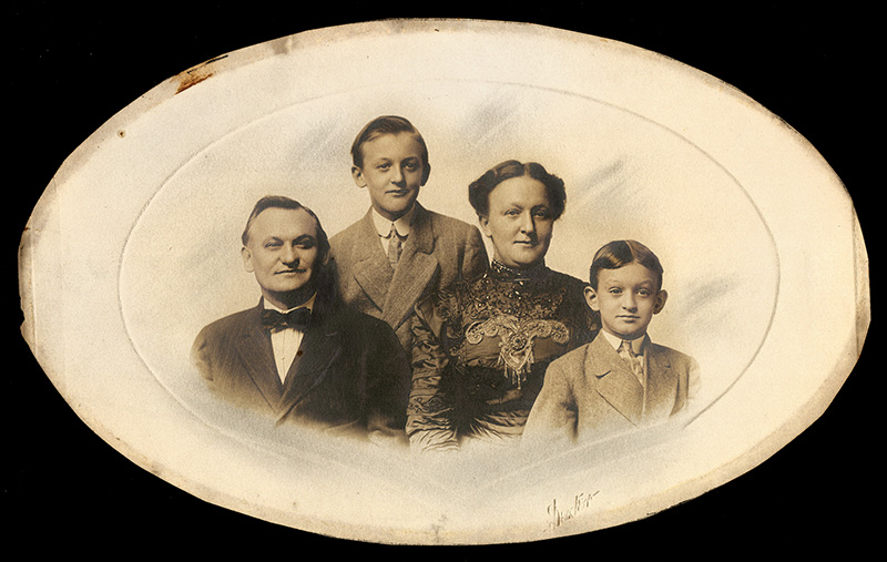 This photo, dated approximately 1910, shows Henry and Anna Willig, Carl's parents, with Carl in the background and Walter in the foreground. Walter is the author's father. Courtesy of Noretta Willig.