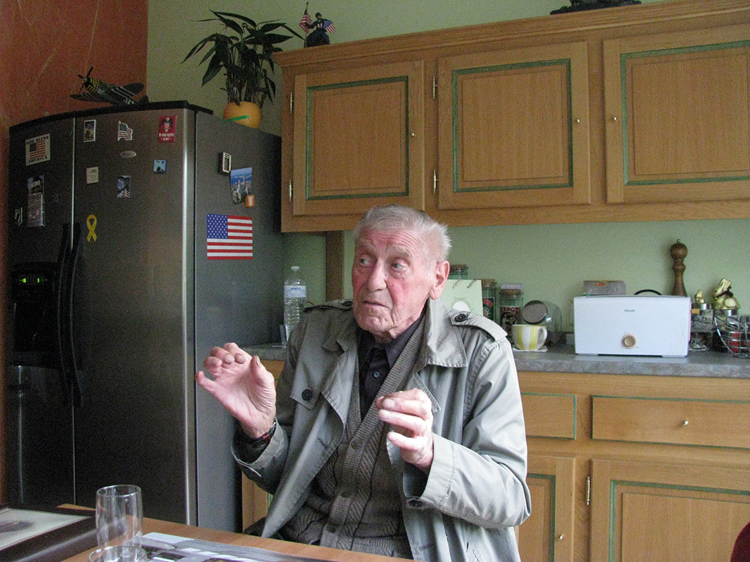 Roger Schneider, himself a French Resistance fighter in World War II and a member of Thanks GIs, tells the story of how he tripped in the woods, accidentally discovering Carl's remains, almost 90 years after Carl died on the last day of the battle. As he spoke, we knew he had told the story many times before and would continue to tell it proudly. Courtesy of Noretta Willig.