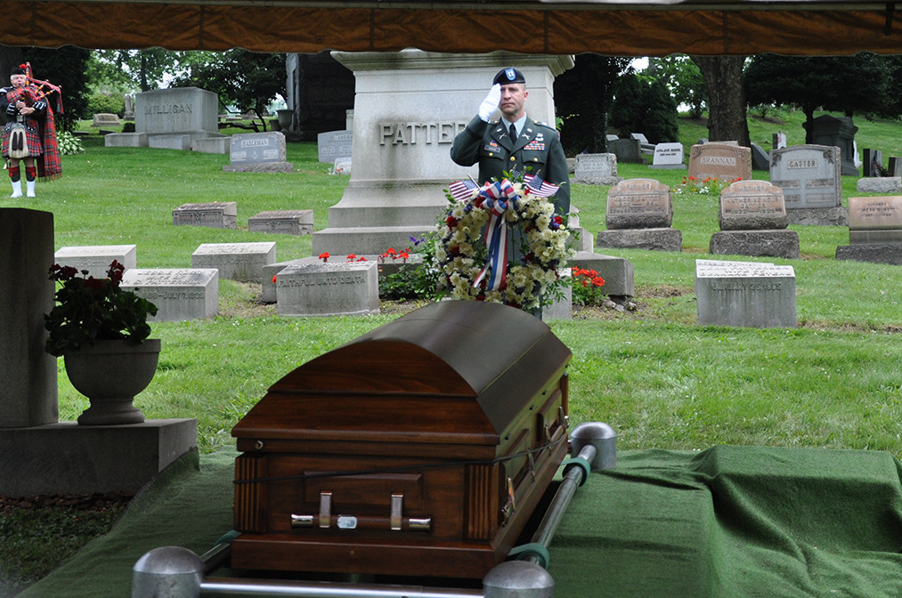 As Carl was laid to rest with his family in McKeesport, Pa., Capt. Eric Gass, Carl's fellow soldier, gives him the final salute. Carl is home at last—90 years after his death. Courtesy of Noretta Willig.