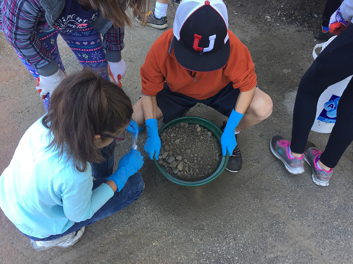 Student sift through dirt in Point State Park during this homeschool class coordinated with both Meadowcroft and the History Center. | Fort Pitt Museum