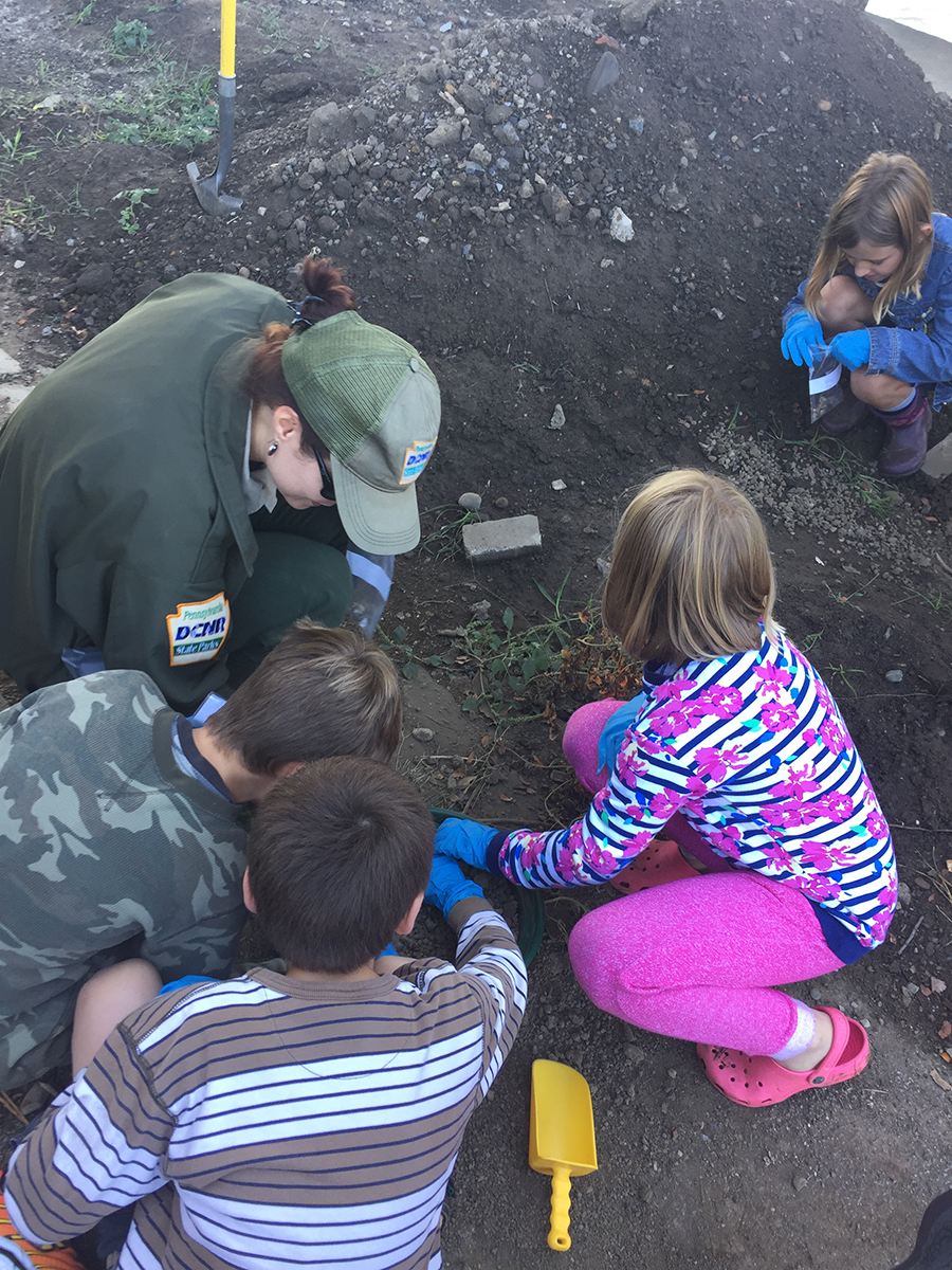 Students sift through dirt unearthed at Point State Park with state employees to identify the history of the Point through simple archeology.   Fort Pitt Museum