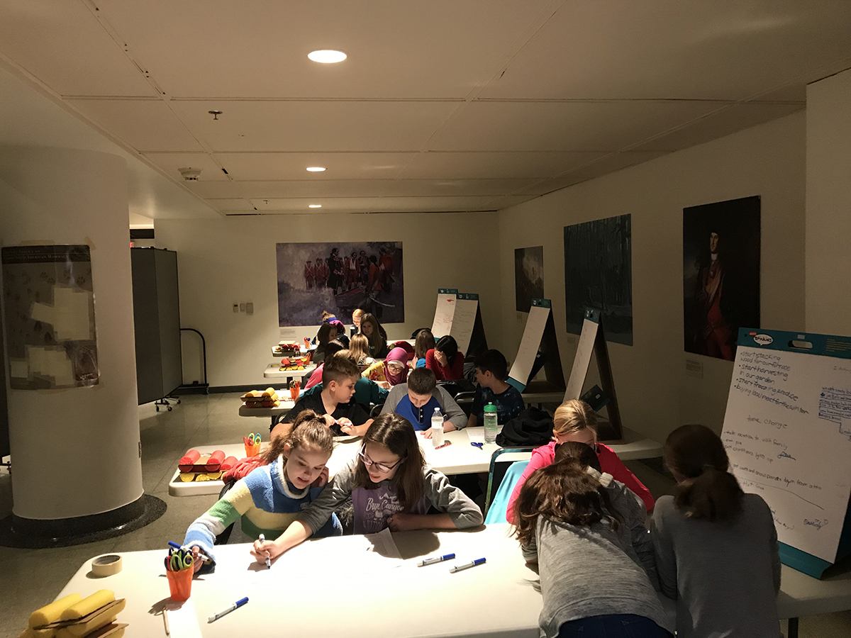 Students reading selections from the Papers of Colonel Henry Bouquet to learn how Fort Pitt, and soldiers in general, prepared for winter.   Fort Pitt Museum