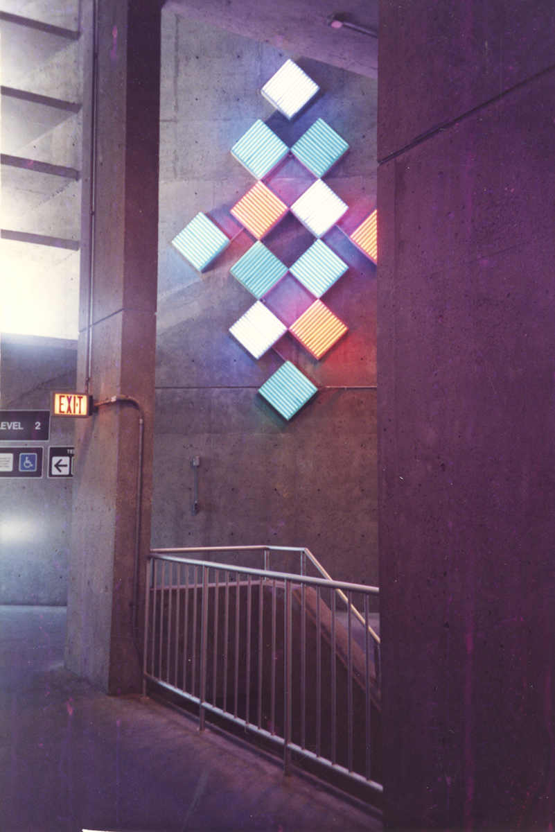Photograph showing part of Jane Haskell's Windows of Light, neon installation in the parking garage at Boston Logan International Airport, 1991. Jane Haskell papers, MSS 1046, Rauh Jewish History Program & Archives. Gift of Jane Haskell.