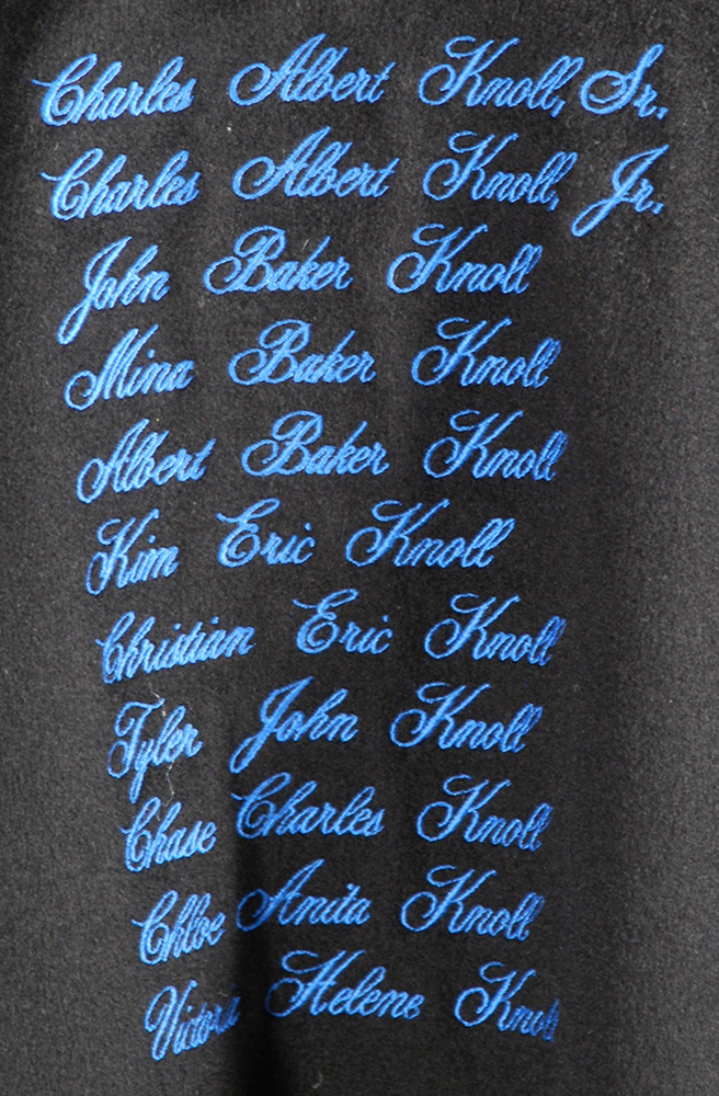 Embroidered names of Knoll's family members on the inside of her jacket.