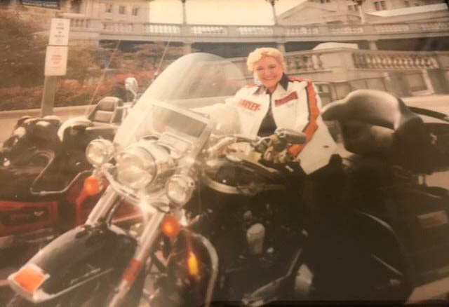 Image of Knoll on a Harley Davidson motorcycle.