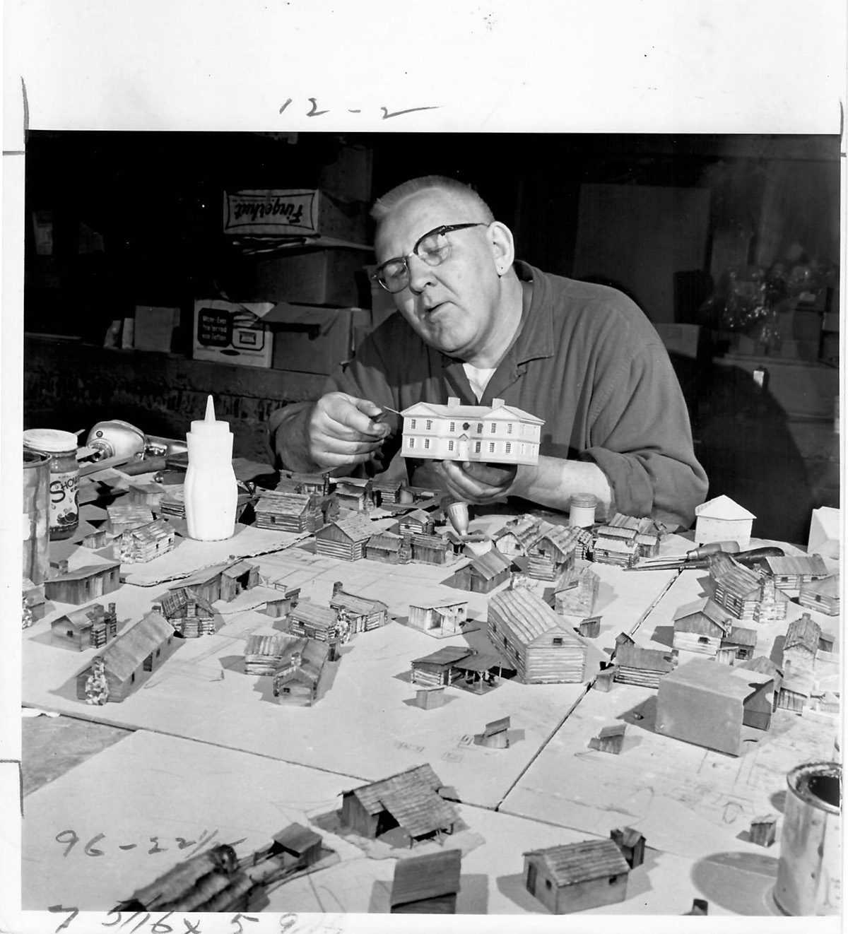 Robert Latta, of Holiday Designs, trims the commandant's home for the Fort Pitt diorama, June 8, 1969. Copyright © Pittsburgh Post-Gazette, 2019.