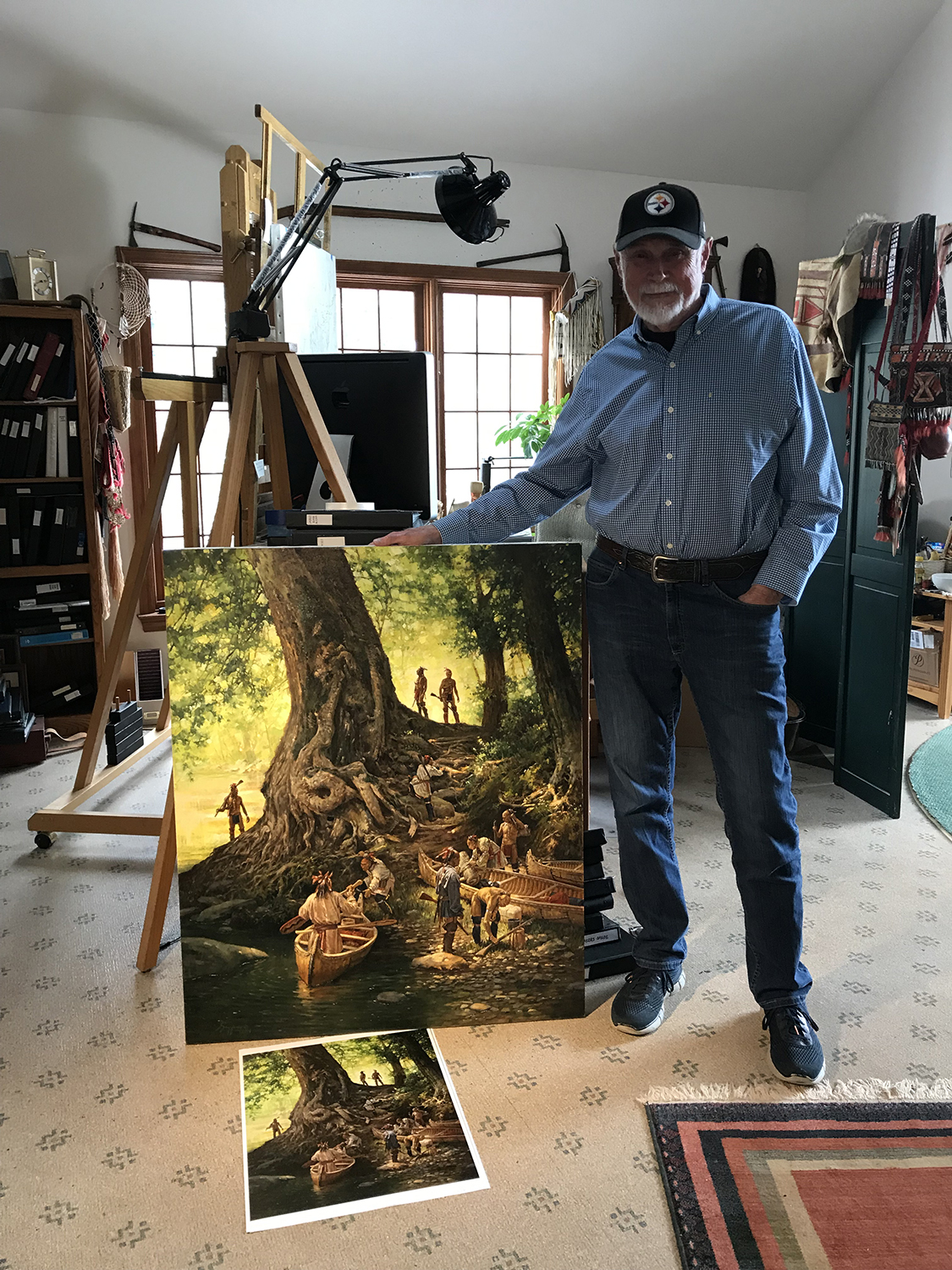 "Robert Griffing with new painting, ""Respect for the Ancients."" Photo by Kathleen Lugarich."