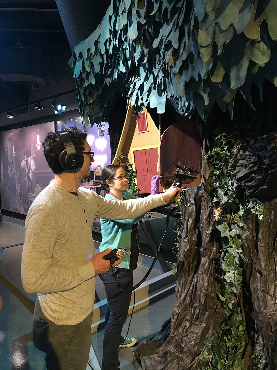 "History Center registrar Nicole Lauletta assists an ""A Beautiful Day in the Neighborhood"" crew member, who records the sound of the living room door opening and closing. Fred Rogers came through this iconic door at the beginning of each episode of ""Mister Rogers' Neighborhood."""