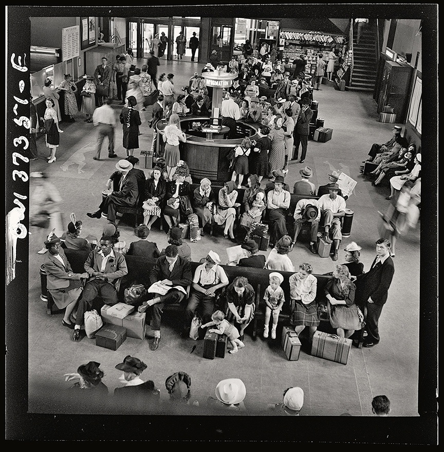 The waiting room at Pittsburgh's Greyhound bus terminal, with circular information desk at center, 1943.
