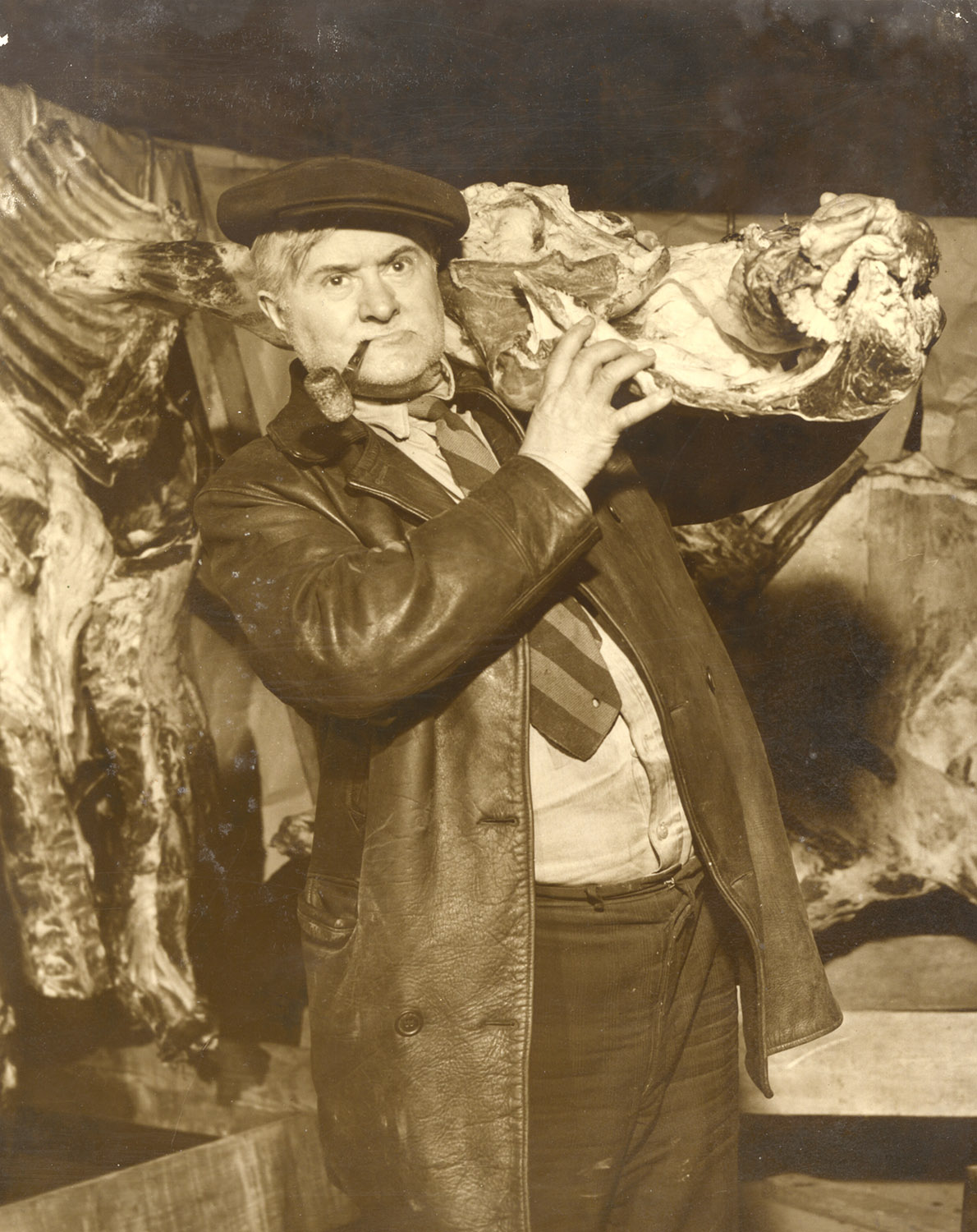 Ray Sprigle poses for a press photo with his black market meat, 1945