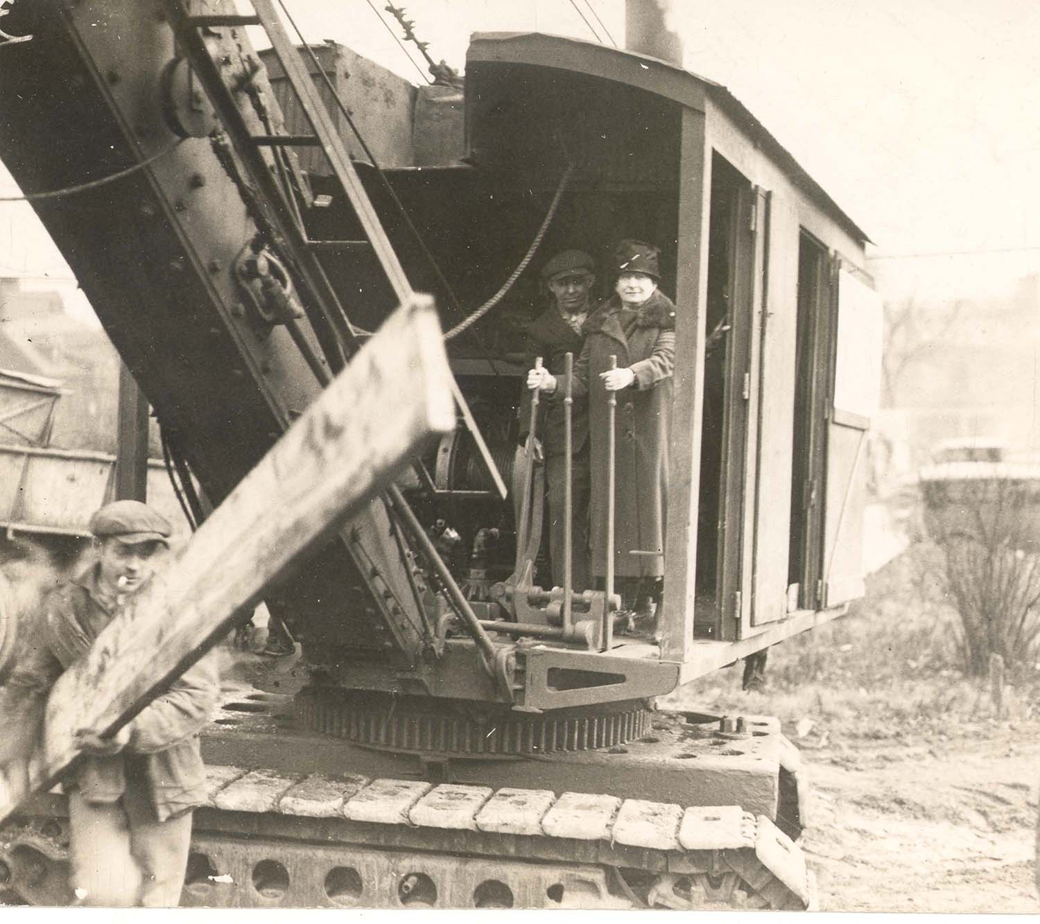 Annie Jacobs Davis operating a steam shovel during the groundbreaking ceremony for Montefiore Hospital on Fifth Avenue, 1927.