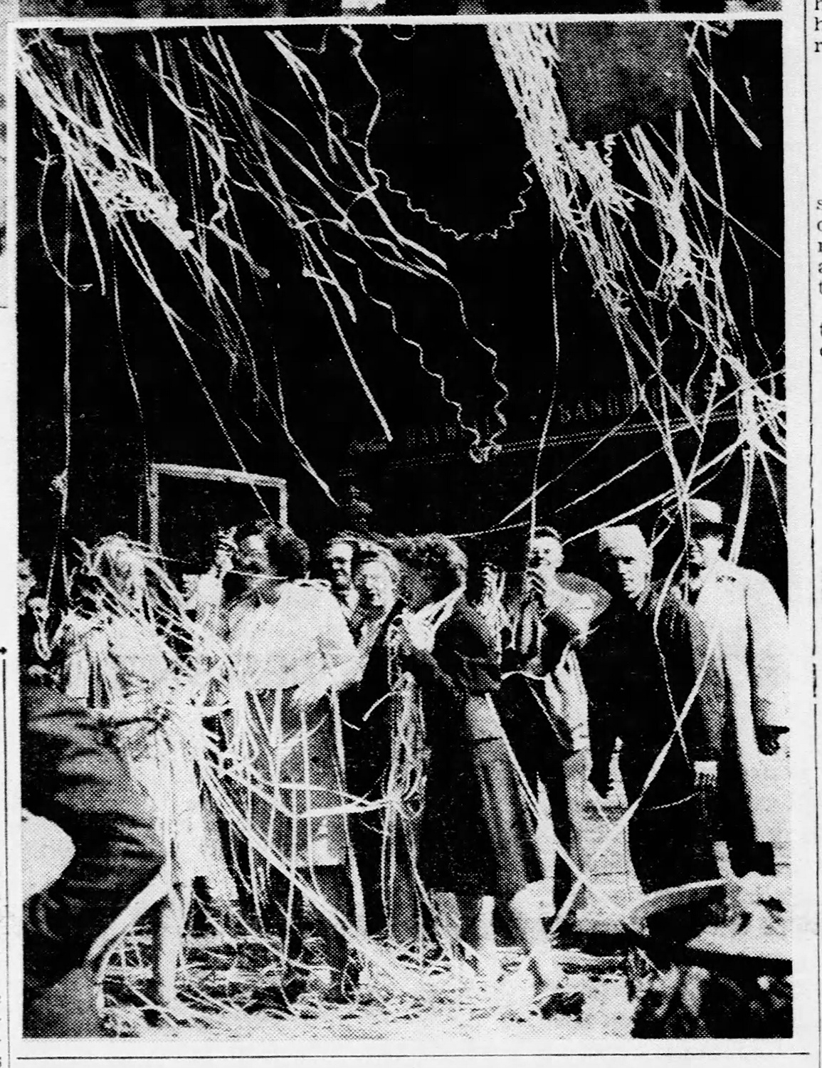 Press photo showing Pittsburghers covered with ticker tape, The Pittsburgh Press, May 8, 1945.
