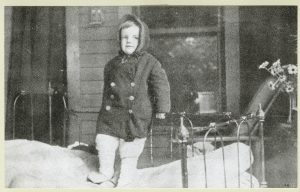 A child on a bed on the porch of the Tuberculosis League of Pittsburgh's Hospital, c. 1910.