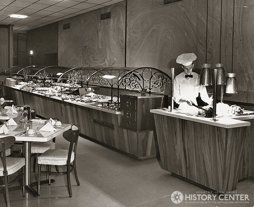 The original all-in-one sneeze guard table at Johnny Garneau's Smorgasbord when it opened in Monroeville, 1958. Gift of Barbara Garneau Kelley.
