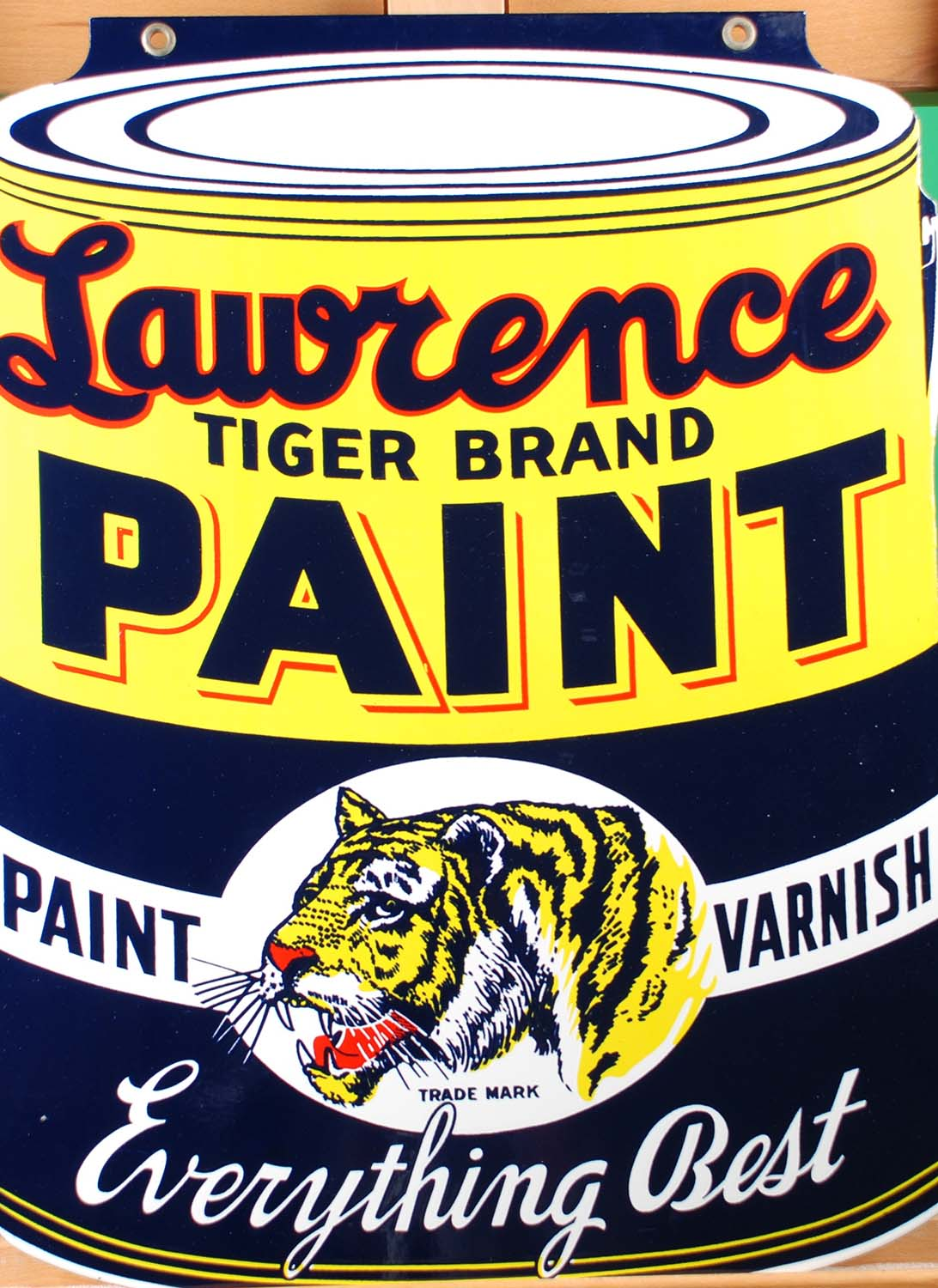 Double-sided enamel sign from the Levine Brothers hardware store that advertises Lawrence Tiger Brand paint. Gift of Levine Brothers, 2012.80.2. Photo by Liz Simpson.