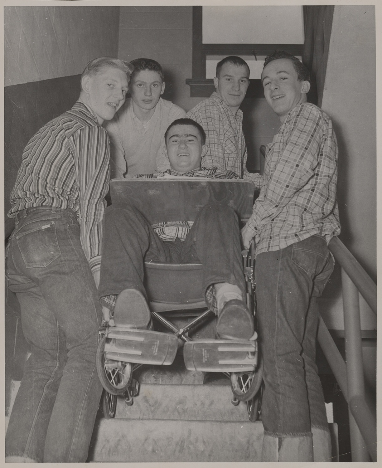 Paul being transported up a flight of stairs by four of his classmates while in high school in 1958. Holly and Paul Dick Family Papers and Photographs, MSS 1177, Detre Library & Archives at the History Center.