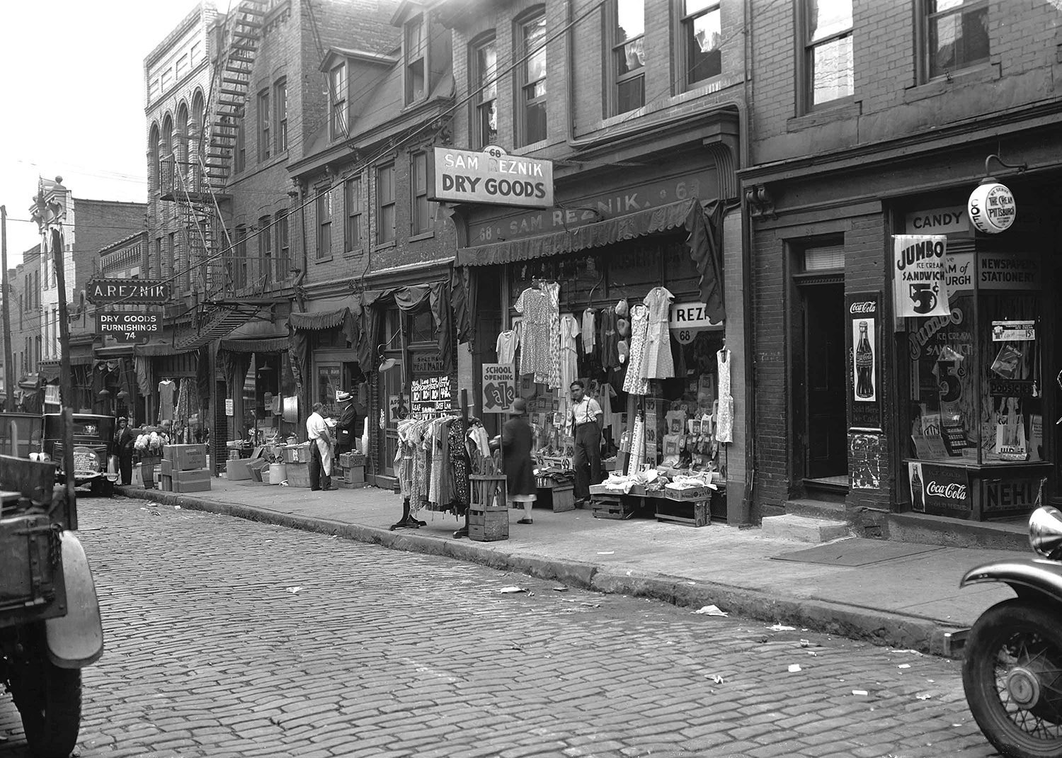 Sam Reznik and his younger brother Abe Reznik immigrated to Pittsburgh around 1904 and both opened dry goods stores of Logan Street. Pittsburgh City Photographer Collection, Archives & Special Collections, University of Pittsburgh.