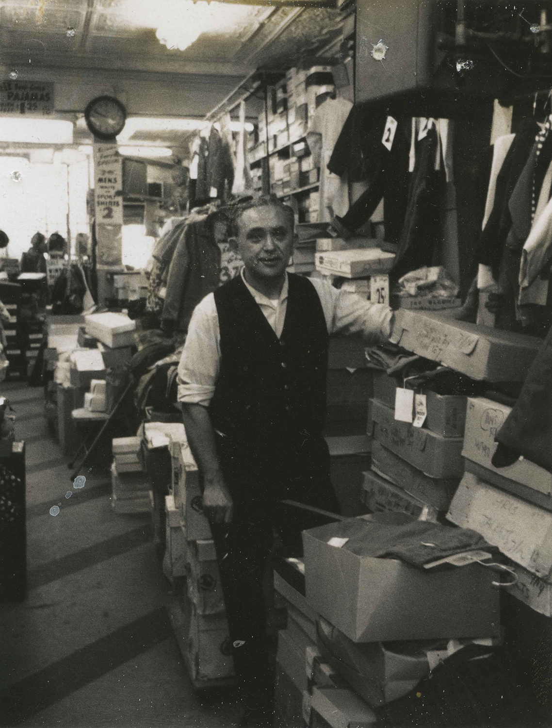 Lawrence Reznik pausing from his work at the Fifth Avenue location of Sam Reznik & Sons. The store moved to Fifth Avenue in the 1950s, after the original Logan Street was demolished during the redevelopment of the Lower Hill. Courtesy of Rochelle Blumenfeld.