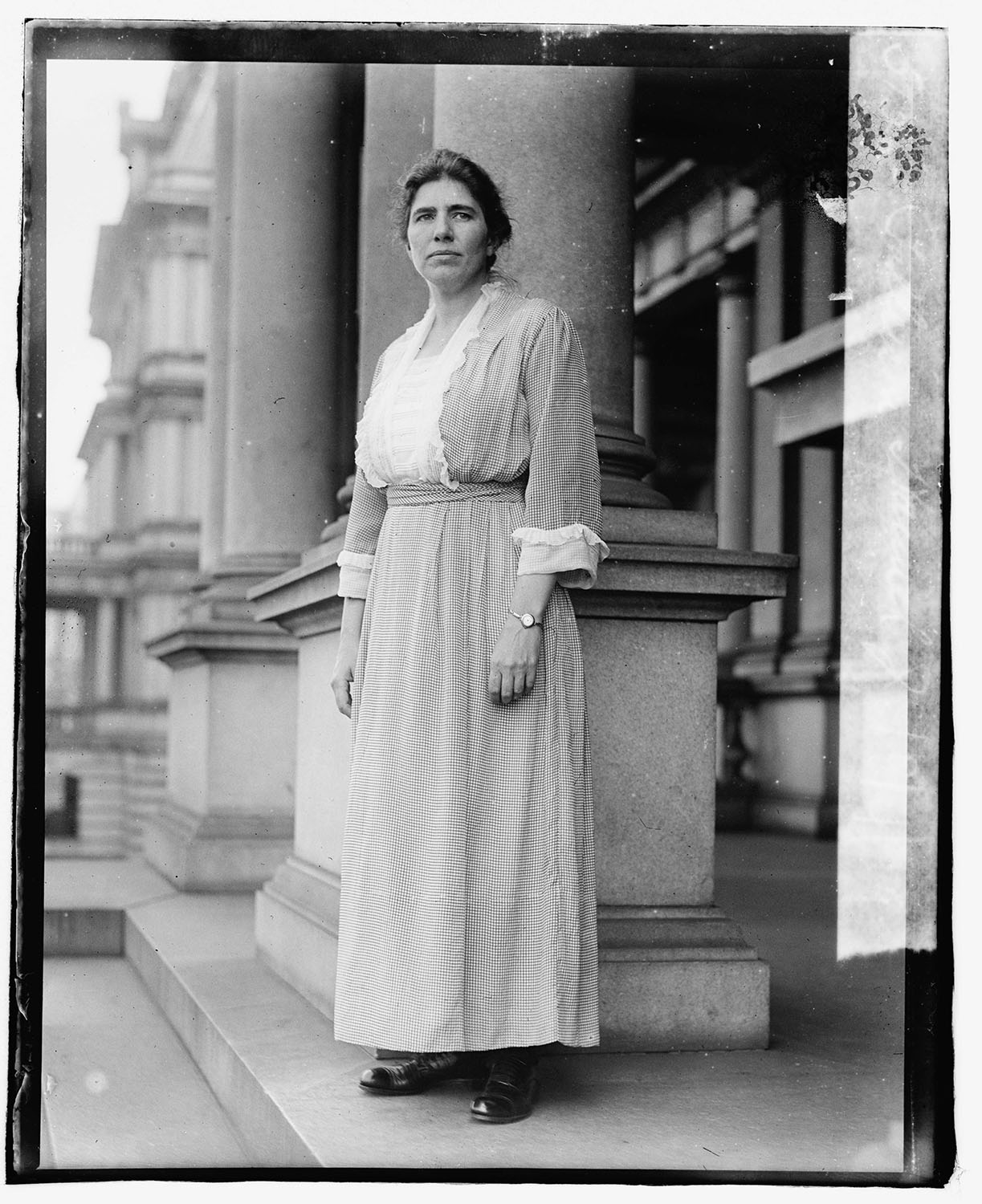 Hannah J. Patterson, appointed temporary assistant to Secretary of War Newton Baker, standing in front of the State, War and Navy Building, Washington, D.C. 1919. Courtesy of the Library of Congress, Prints and Photographs Division.