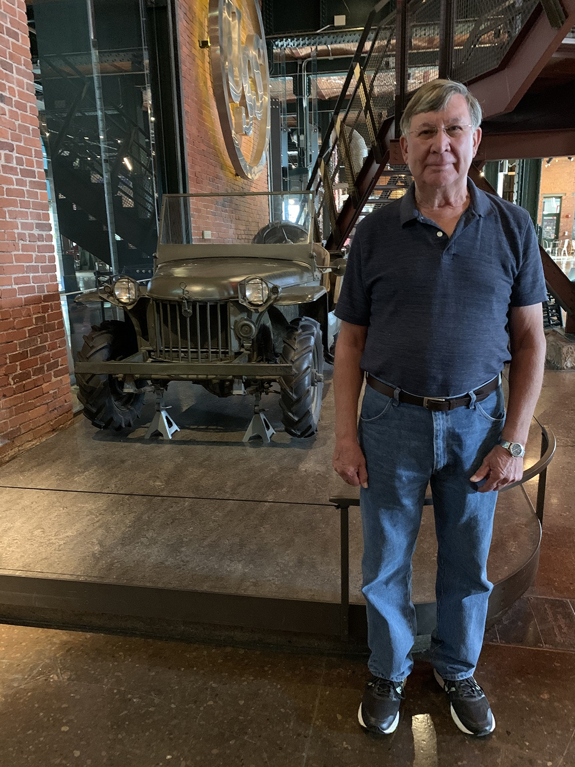 Ralph's son, Dave Turner, with the world's oldest surviving jeep (on long-term loan from the Smithsonian) in the History Center's first floor Great Hall.