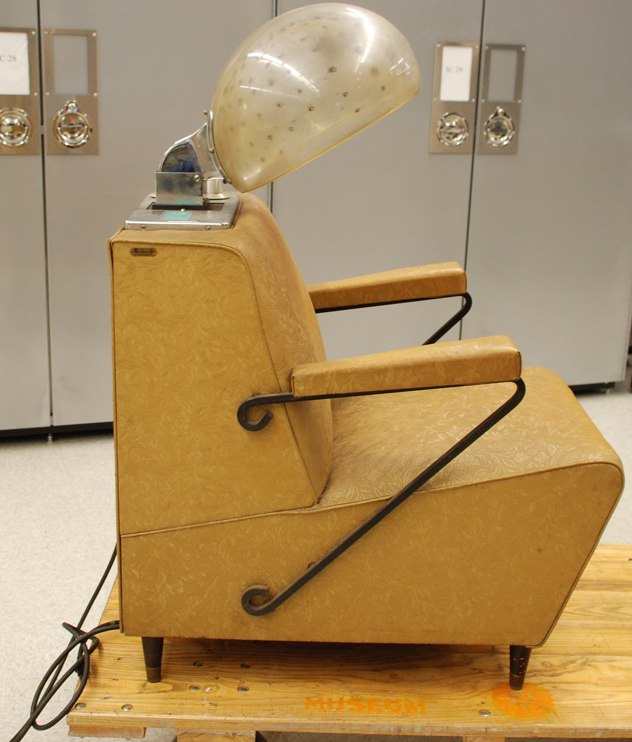 Salon chair used in one of Gloria Giddens' two Hill District beauty parlors, c. 1960.