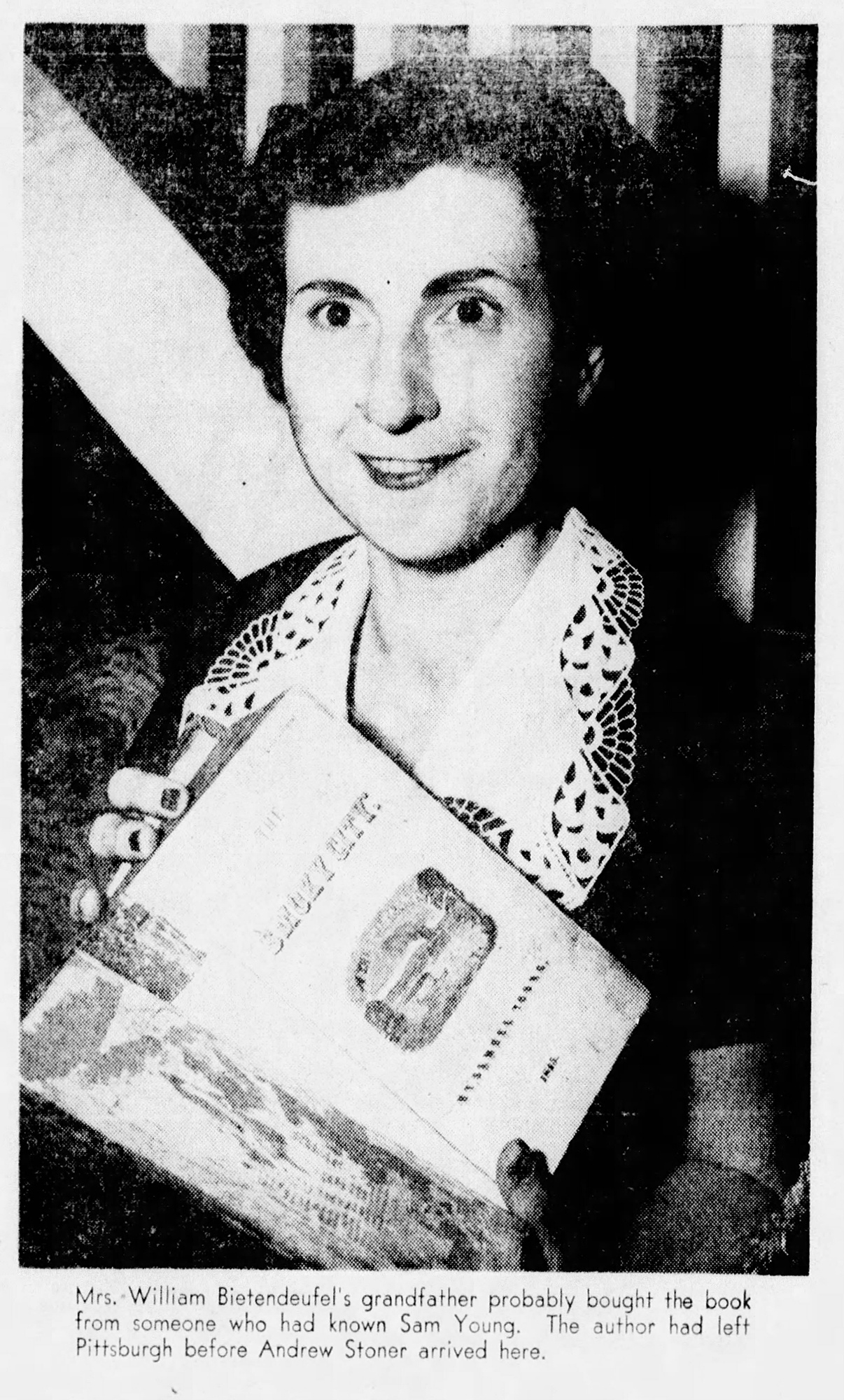Press photo showing Mrs. William Bietendeufel's discovery of a copy of The Smoky City in the attic of her Mt. Washington home, 1954. Pittsburgh Press, September 19, 1954.