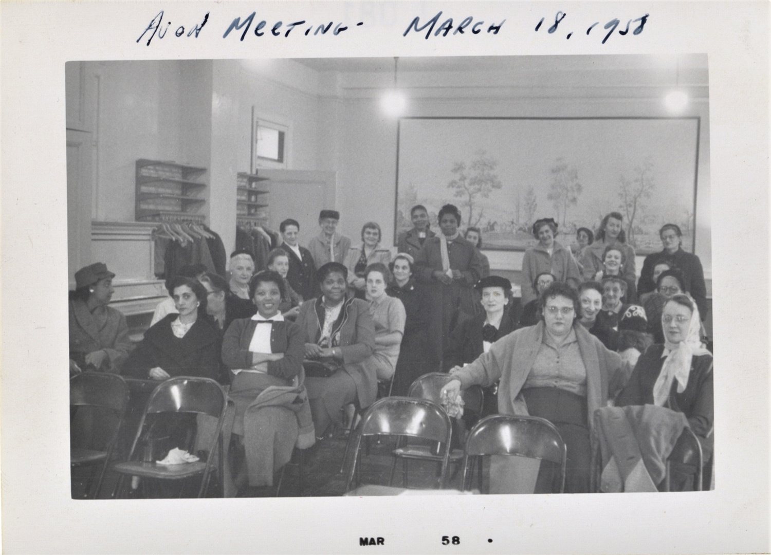 Photograph of an Avon district business meeting, March 18, 1958.