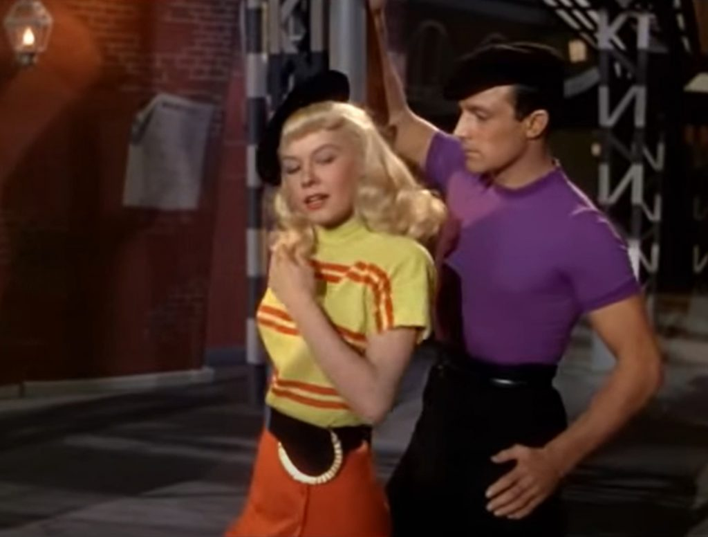 """Gene Kelly and Vera Ellen appearing in the ballet """"Slaughter on Tenth Avenue"""" from Words and Music, 1948. Screen capture from MGM trailer."""