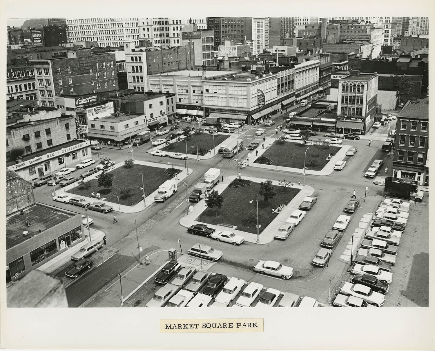 Market Square Park, July 1964. The footprint of the old Diamond Market can still clearly be seen in the park's layout of four separate quadrants. From the Allegheny Conference on Community Development photographs, MSP 285, Detre Market Square Park, July 1964.