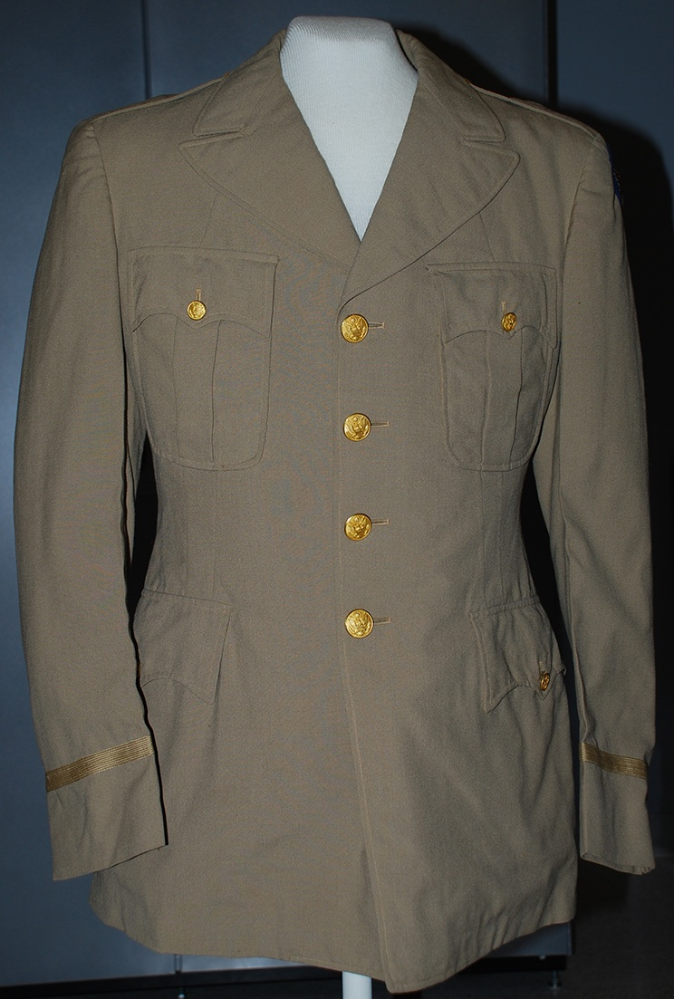 Tan cotton Tuskegee Airman's jacket, worn by William A. Johnston. Gift of Martha Johnston Wilkins.