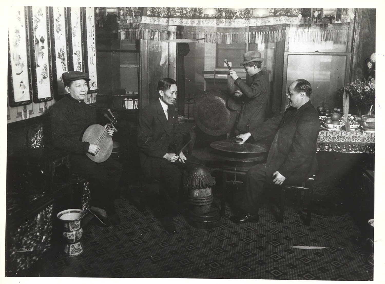 Men play traditional instruments in Chinatown, 1912. Gift of Elenore Seidenberg, MSP 566, Detre Library & Archives at the History Center.