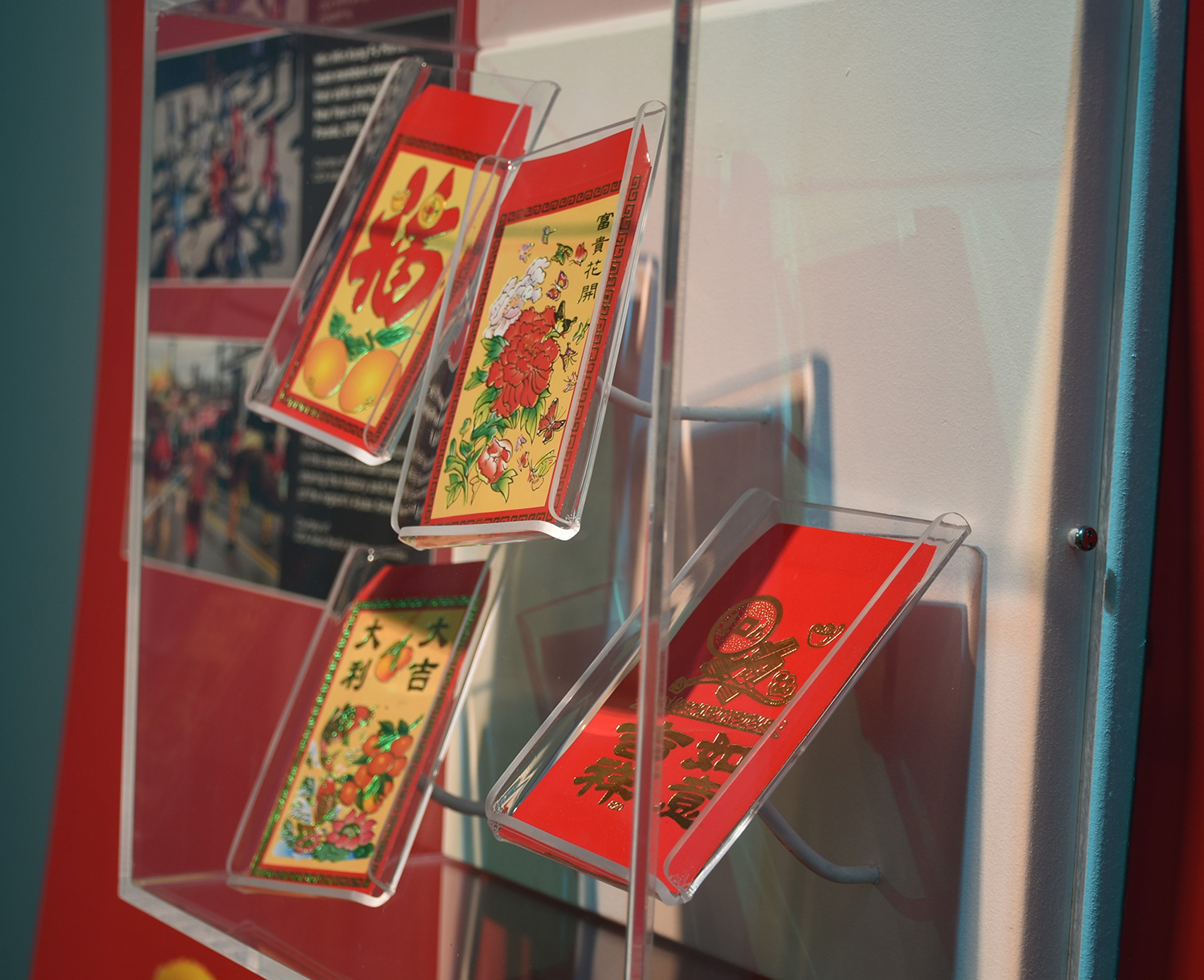 Red envelopes for Chinese New Year, on display in A Very Merry Pittsburgh, 2019. Heinz History Center Museum Collections.