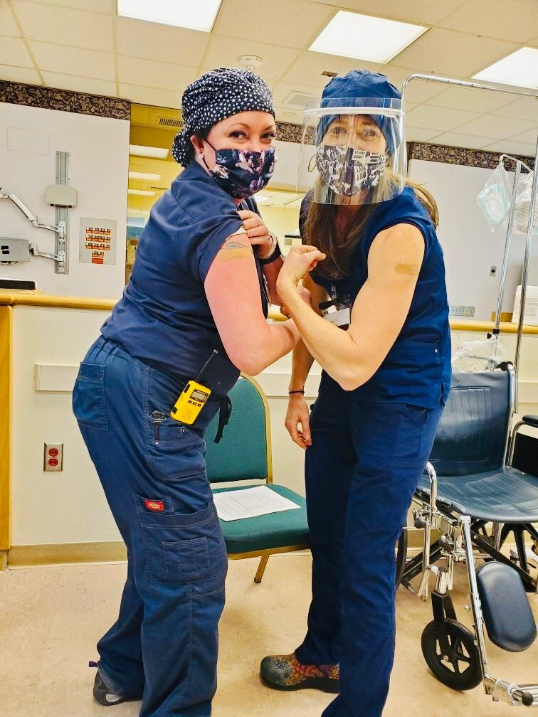 Nurse Christi Bolaños (right) and a colleague at Allegheny General Hospital celebrate receiving a COVID-19 vaccine, 2021. Courtesy of Christi Bolaños.