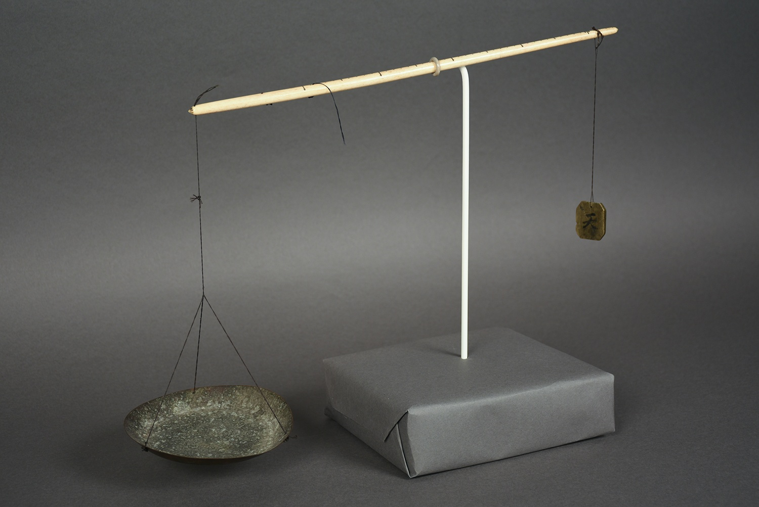 Scale used in the Git Lee General Merchandise Store, c. 1940 This scale was used for weighing herbs, mushrooms, dried nuts, roots, and berries in the family store. Gift of the Git Lee family, 2004.154.5, Heinz History Center Museum Collections.