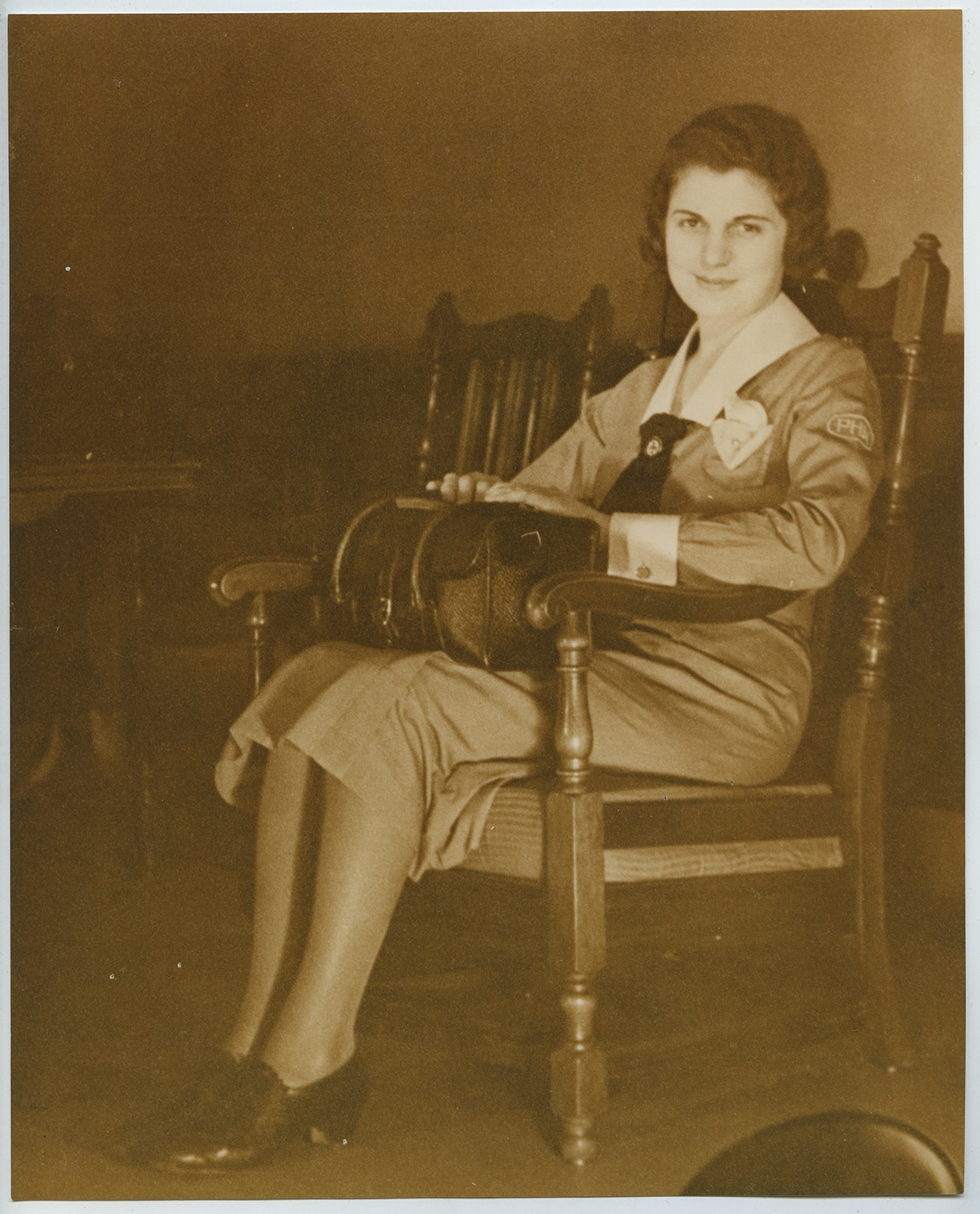 Anne M. Nixon sits with her visiting nurse's bag, 1930s. Gift of Anne M. Nixon, 1995.0049, Heinz History Center Museum Collections.